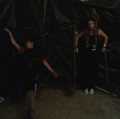 "Juniors Jack Young and Eliza Brantley in the ""Children of the Corn"" section of the maze. Photo by John Keeler"