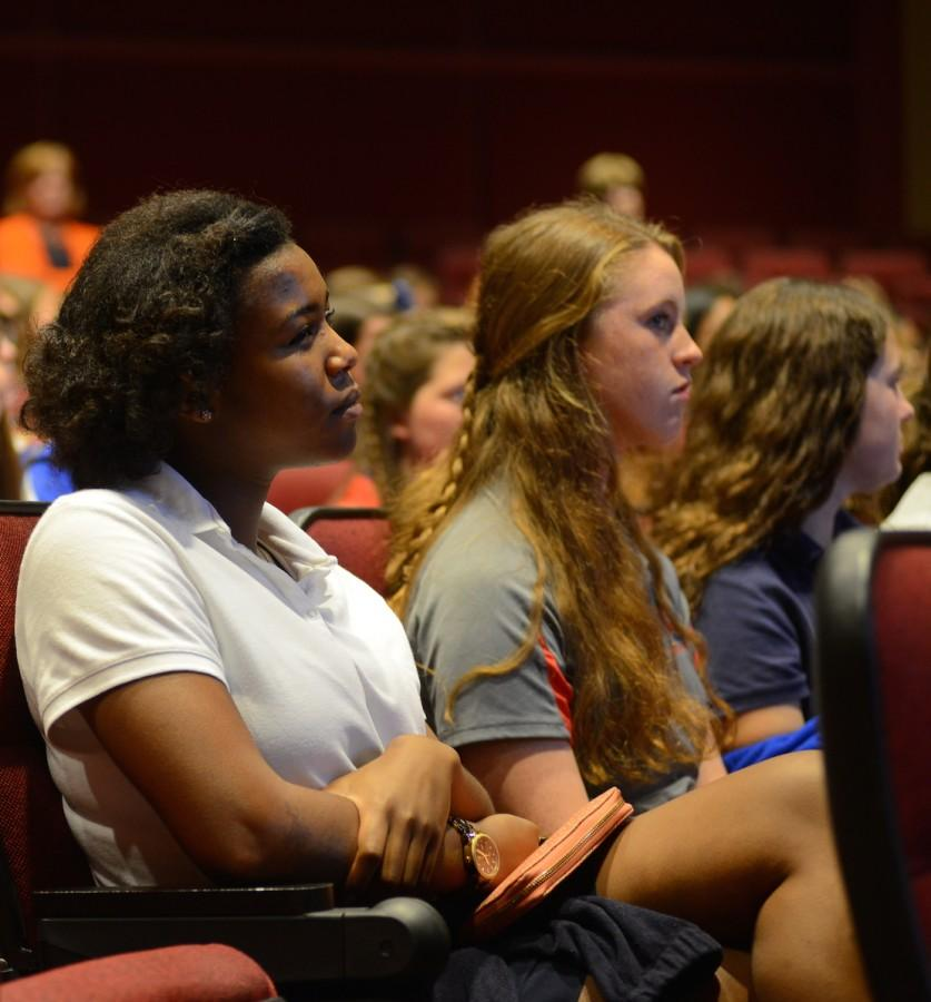 Prep juniors Amber Mabry, McKenzie Robinson, and Claire McGehee listen to the symposium's speakers. Photo courtesy of Ms. Vicki King.