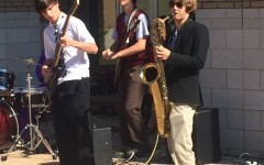 Tyler Wann, Adam Field, and Thad Cochrane play for the assembled students