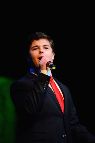 "(photo courtesy of Mr. Hubert Worley) Lawson Marchetti sings ""I Can't Give You Anything But Love"""