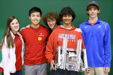 Leah Thomas, Jack Huang, Daniel Palmer, Joshua Michael, and Isaac Clapp, with JP robot. (photo courtesy of Mr. Clay Conn)
