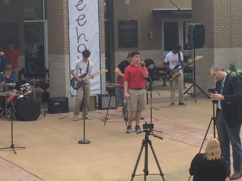"Lawson Marchetti, Jordan Barclay, Dees Baker, and Tyler Wann perform ""Gimme Shelter."""