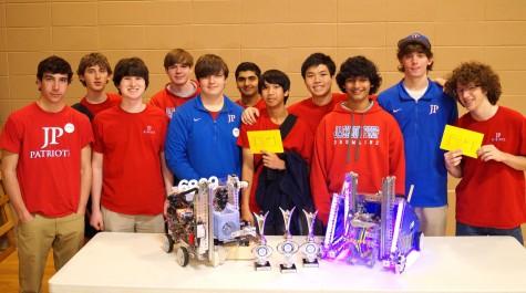 Robotics team and their robots