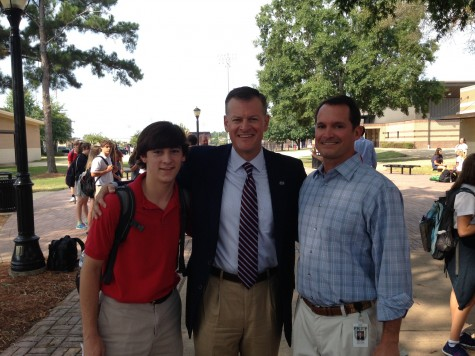 """Junior Brendon McLeod (left) and Coach Will Crosby (right) with Mississippi State University athletic director Scott Stricklin, who led a discussion of the book """"Benching Jim Crow"""" by Charles H. Martin."""