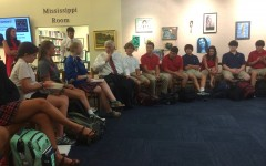 A group of students in the library talk to author and former Ole Miss Chancellor Dr. Robert Khayat.