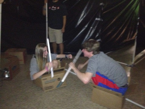 Hannah Hederman and Jackson Phillips, taking a break from literary haunted house construction, pvc-fighting while squooshed into boxes. Photo courtesy of Dr. Lisa Whitney
