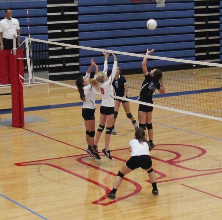 Volleyball Spikes to Third Place