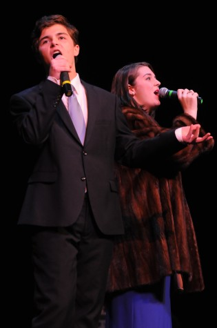 "Lawson Marchetti and Madeline Porter singing ""Baby It's Cold Outside"" by Frank Loesser. Photo courtesy of Hubert Worley Photography."