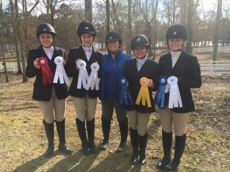 Jackson Prep Equestrian team members smile after another successful show. Pictured from left to right are Miranda Davis, Gayle Grantham, Mandi Powers, Miriam Berry, and Sarah Riley Jicka. Photo courtesy of Sarah Riley Jicka