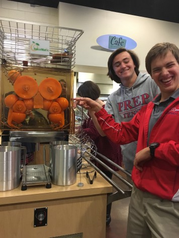Prep students, Hayes Newcomb and Tate Fowler, test out the new Juicer. Photo by Ann Clardy Byrd.