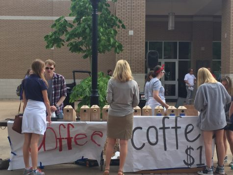 Earthwinds staff members serving coffee.