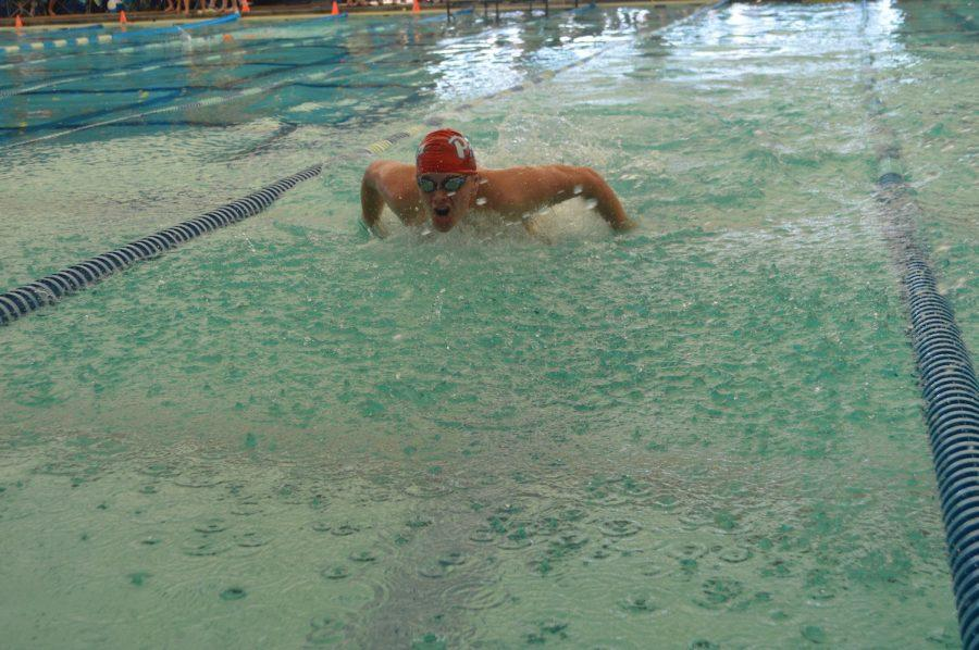 Junior Ben Burnett swims the butterfly. Photo by Madeline Claire Hughes