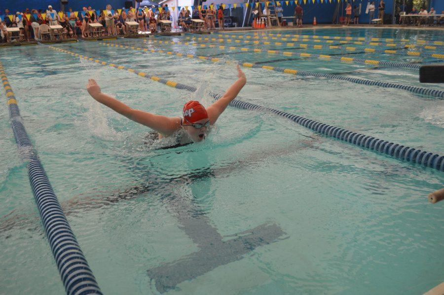 Junior Sidney Wheat swims the butterfly. Photo by Madeline Claire Hughes