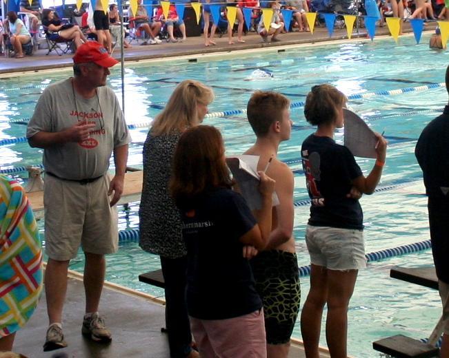 Coach Luke Nealey poolside. Photo by Stewart McCullough