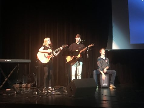 (left to right) Maclain Kennedy, Wesley Roberson, and Jennings Duncan lead worship. Photo by Chatham Kennedy