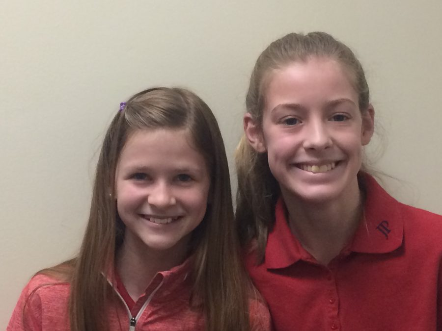 7th grade girls Anna Voynik and Havens Smith are excited for book club. Photo by John Henry Andress