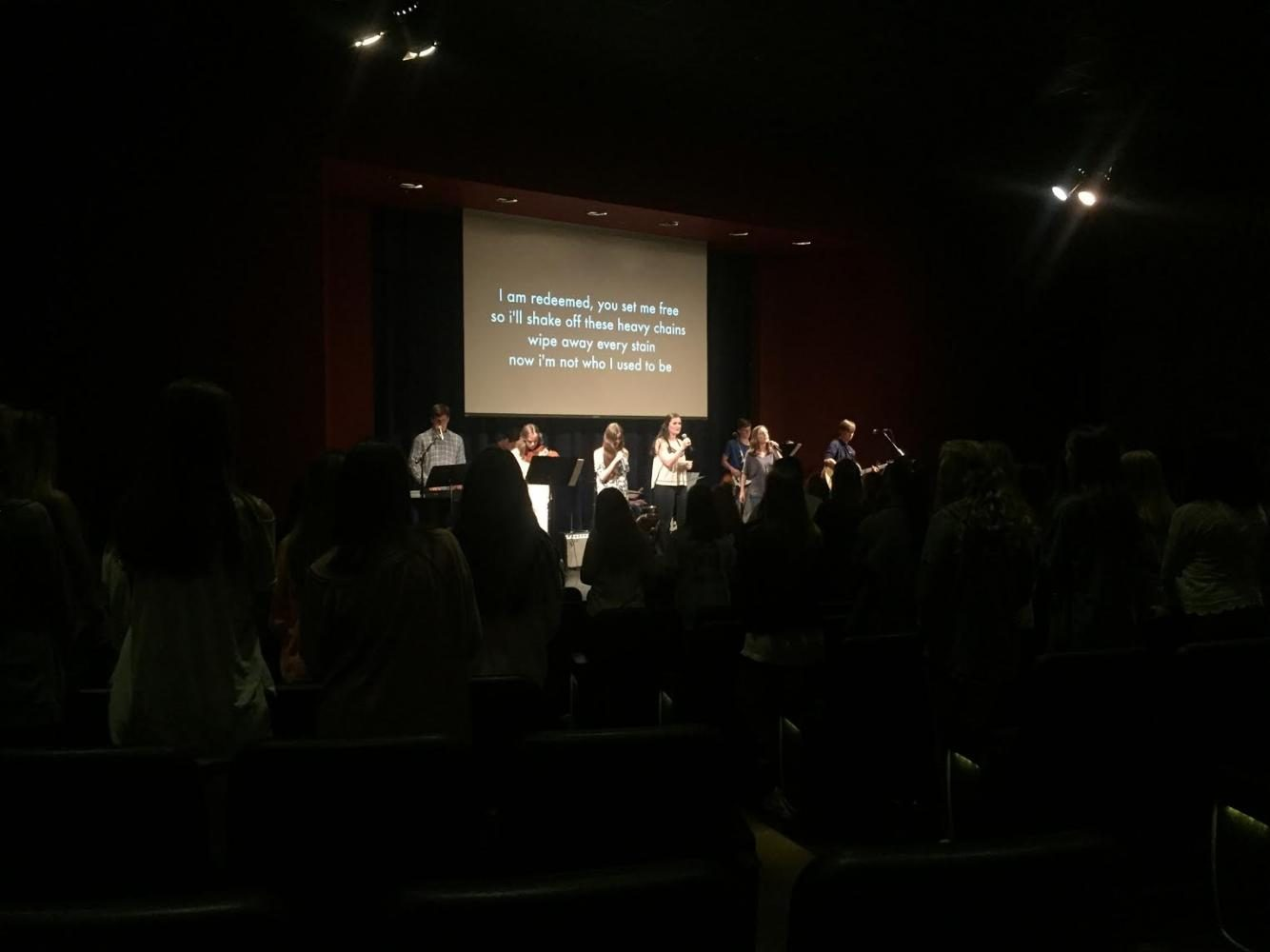 Members of the Unleash Band sing and worship before students. Photo by Preston Dubberly.