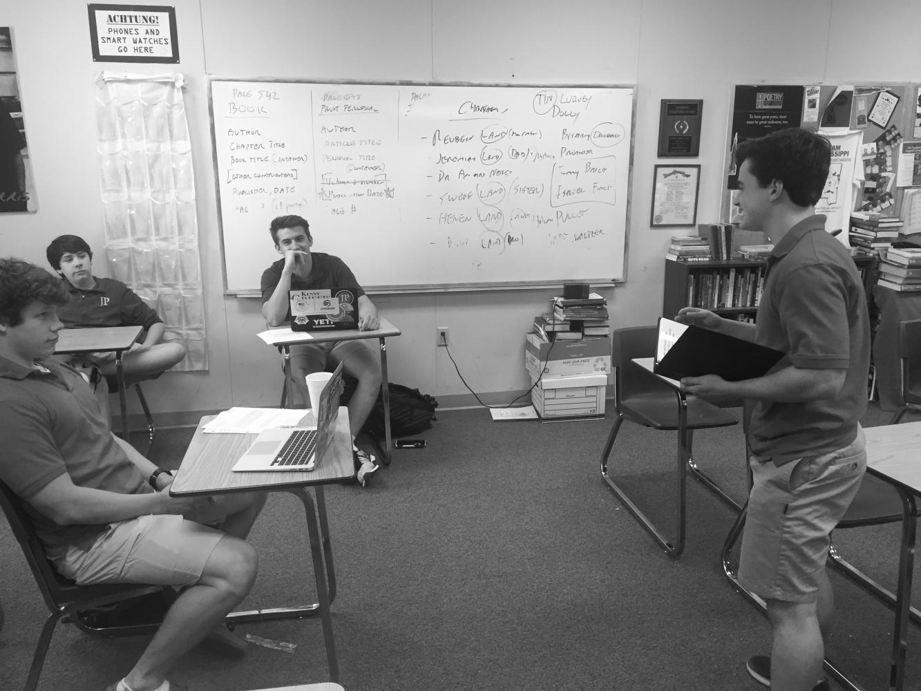 Sophomore Jack Mullen presents a case to his fellow team members.