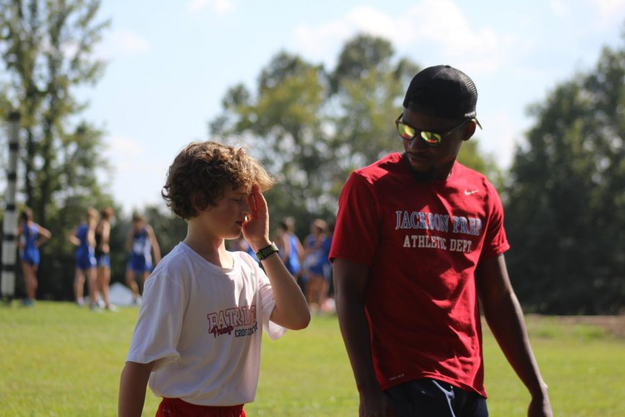 Coach Daniel Burnett encourages one of the runners before the race.