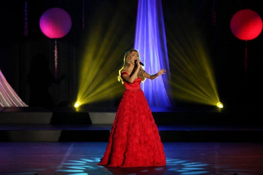 Tori+singing+%22Tomorrow%22+in+the+talent+part+of+the+pageant