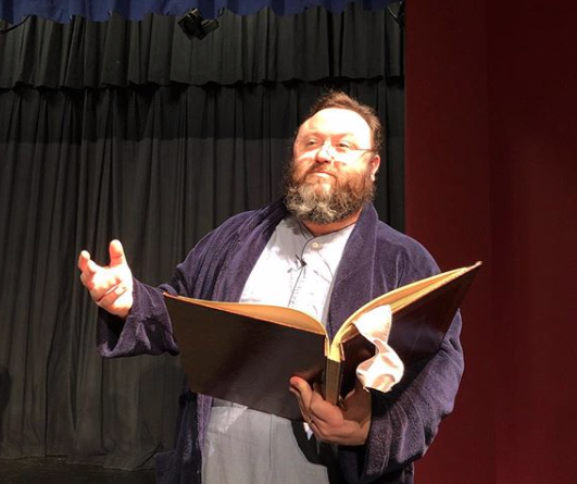 Mr. Hughes, as the Narrator, got to eat cookies during the play.