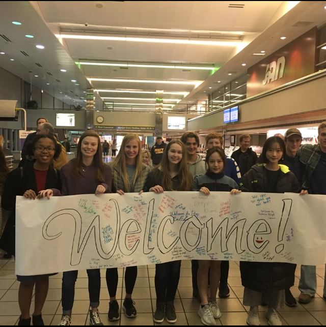 Prep students prepare to meet Chinese visitors at the Jackson airport.