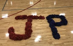 Pom-poms spell out Jackson Prep on the basketball court.