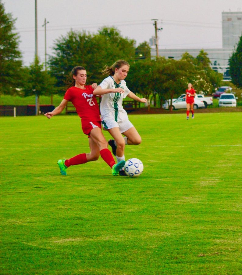 Kelsey making a defensive move at an opposing player during a Prep soccer game. Photo courtesy of Kelsey