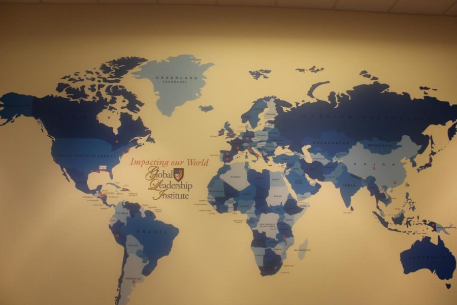 The map of the world in the Global Leadership Institute offices gives would-be travelers some locations to aim for.