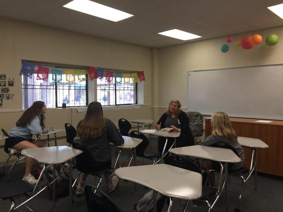 Ms. Katie Lucky leads a discussion of