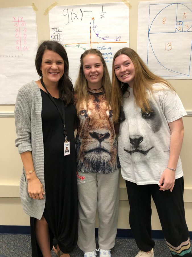 Ms. Kayton Barnes in her classroom with Mayrant Gonwa and Lilly Grace Sites