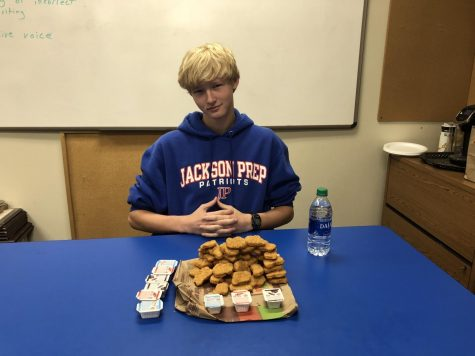Camp Carter poses confidently with his stack of 50(ish) chicken nuggets.