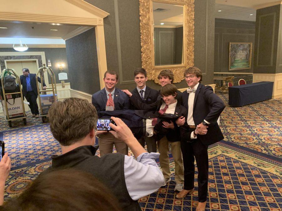 Senior boys Rimes Rutledge, Alex Stradinger, Jacob Perkins, and Ben Johnson lift junior Cass Rutledge as things get giddy on the last morning of Youth Legislature.