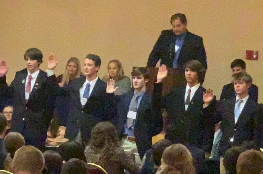 Youth Legislature governor-elect Cass Rutledge (far left) is sworn in along with other new officers, as outgoing governor Alex Stradinger (right, in back) watches.