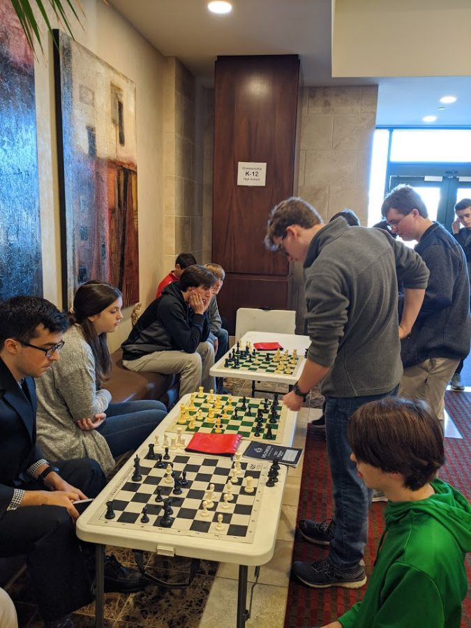 Chess+team+warms+up+before+the+tournament.