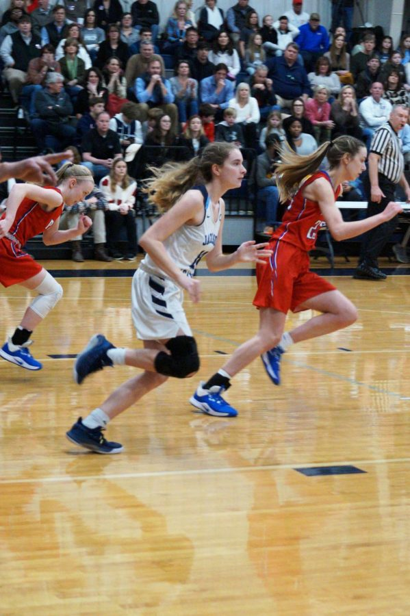 Julia Stradinger and Andie Flatgard race down the court.
