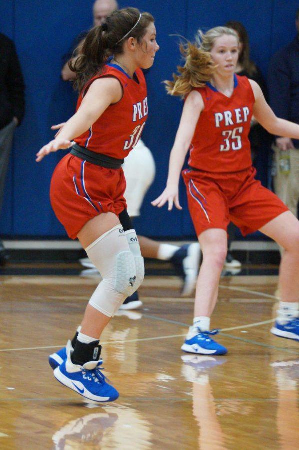 Olivia Sasser and Mackenzie Shoemaker play defense.