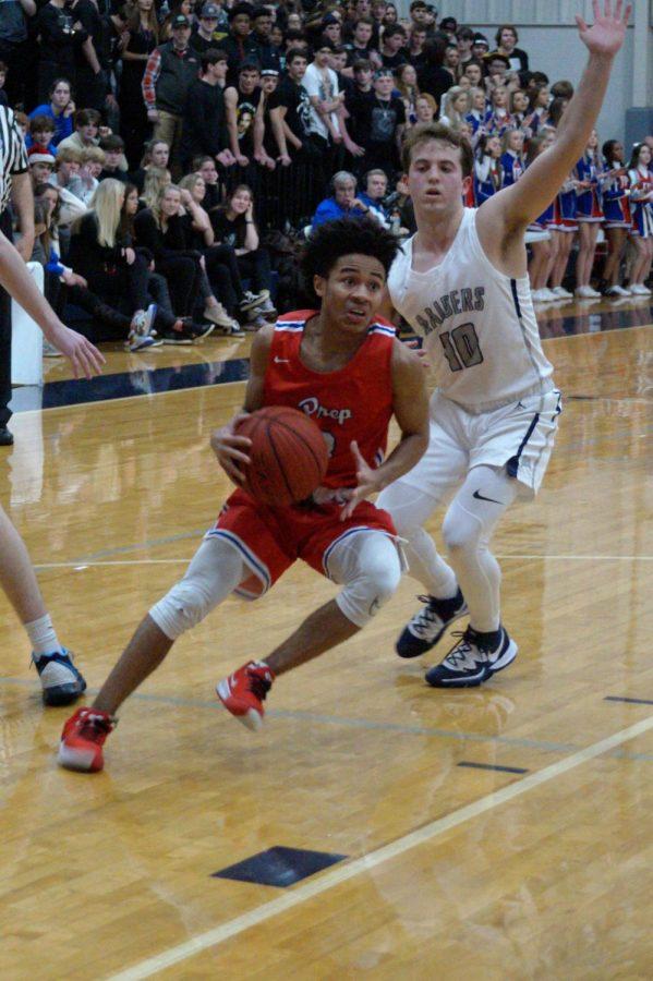 Cam Brent prepares to shoot a basket.