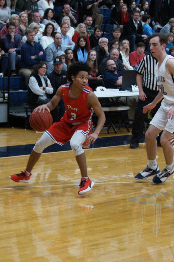 Cam Brent pivots in preparation to dribble the ball.