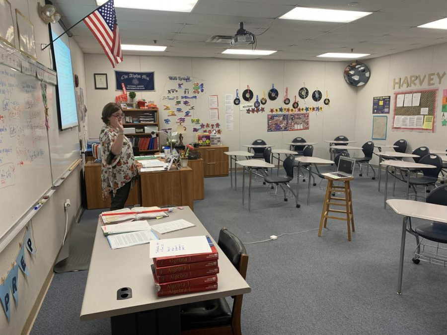 Ms. Margaret Harvey addresses her math class to the laptop transmitting it to her junior high students at home.