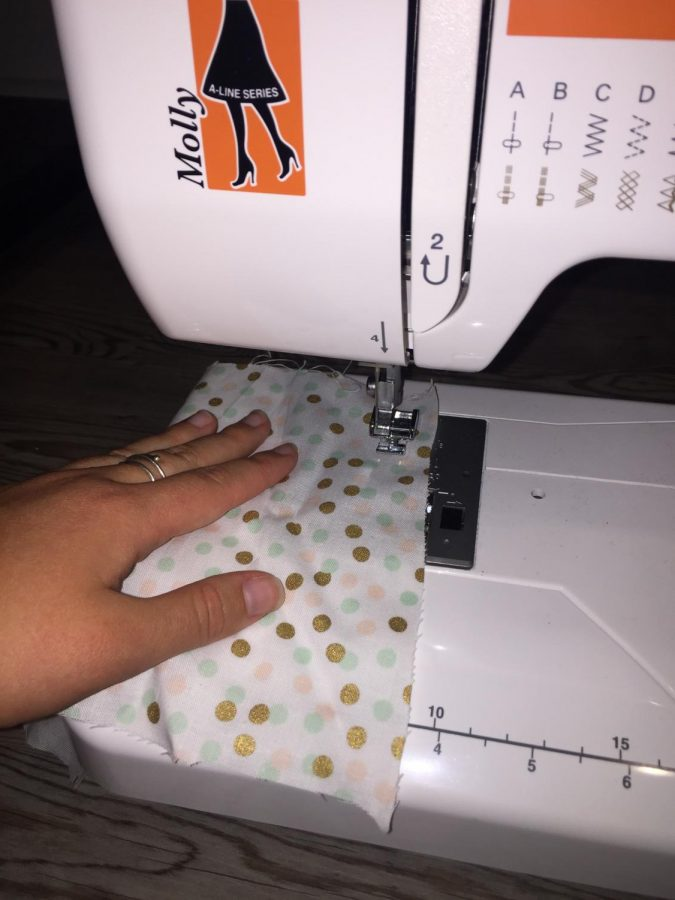 Fabric and a plan are all you need to make protective masks. A sewing machine can help as well.