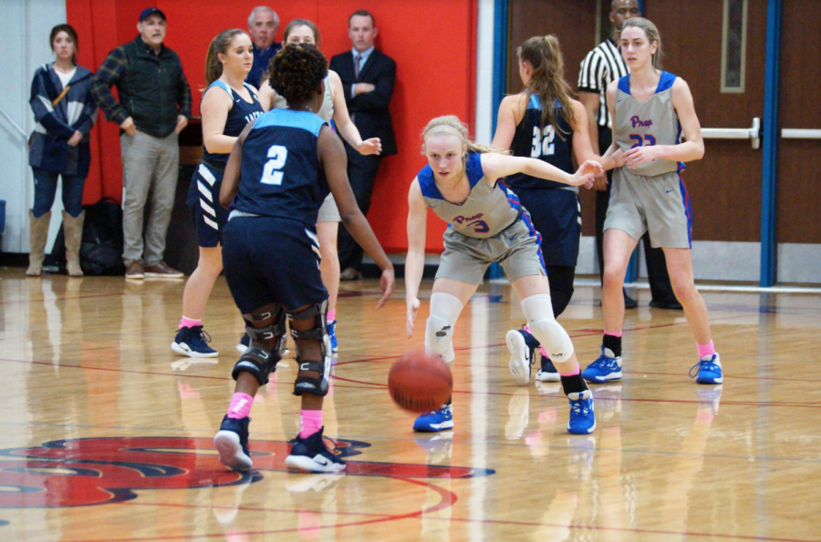 Sophomore guard Andie Flatgard stops her opponent near the half-court line during the regular season.