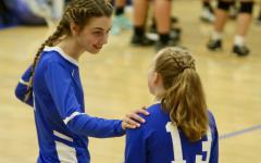 Senior Julia Zouboukos shares some wisdom with Sophomore Meg Branning.