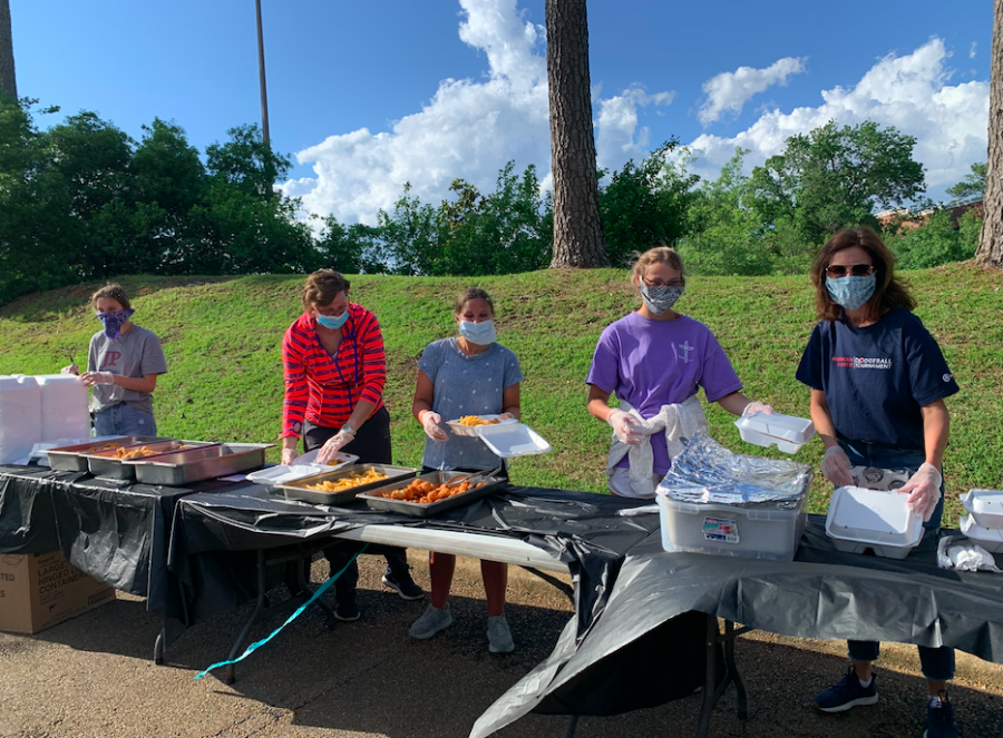 Prep students help serve the community through a catered dinner