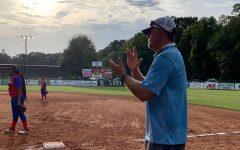 Coach Jay Powell coaching defense for the JV softball team.