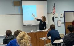 Ms. Ritchie teaching algebra to her ninth-grade students.