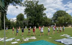 The girls' youth group at First Presbyterian Church maintains social distance while playing a game outdoors.