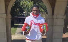 KD Smith holds up some of the peanut butter donated for the MAD Project