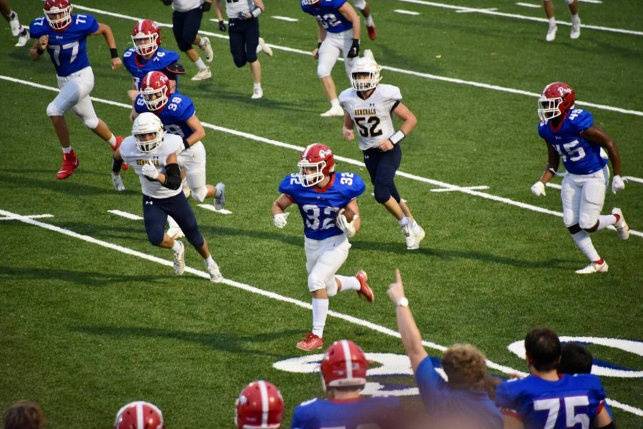 Sam McMullan rushes towards the endzone to extend the Patriots lead. Photo courtesy of Jennifer Mooneyham