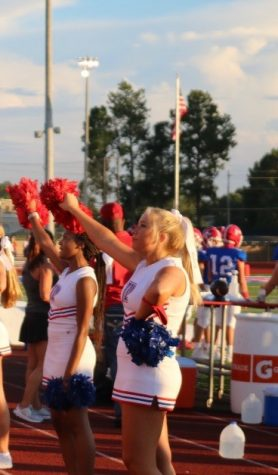 Sophomore cheerleader Elam Roberson cheers at the Prep vs. Heritage football game.